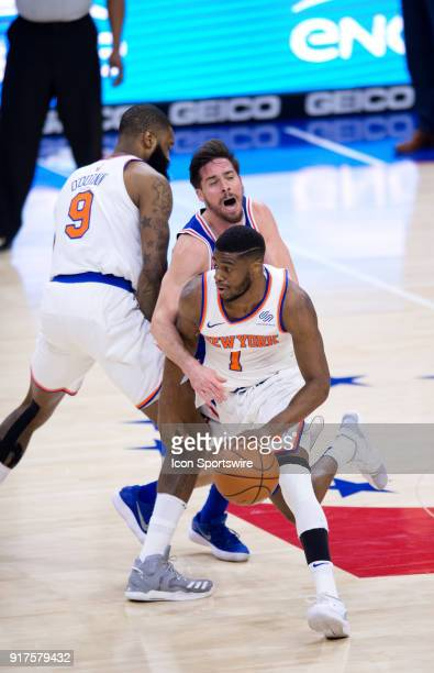 New York Knicks Guard Emmanuel Mudiay carries the ball by Philadelphia 76ers Guard TJ McConnell as he is fouled by New York Knicks Center Kyle...