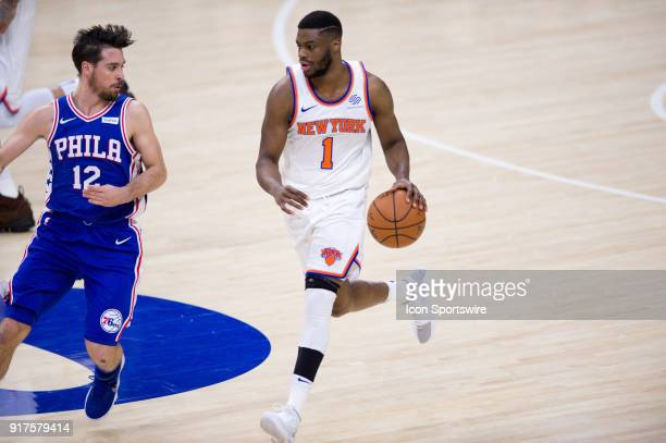 New York Knicks Guard Emmanuel Mudiay carries the ball up court chased by Philadelphia 76ers Guard TJ McConnell in the second half during the game...