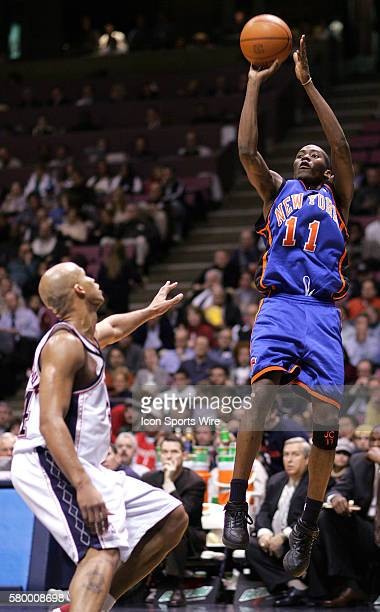 New York Knicks guard Jamal Crawford shoots over Nets Richard Jefferson in the first half in East Rutherford NJ Dec 14 2004