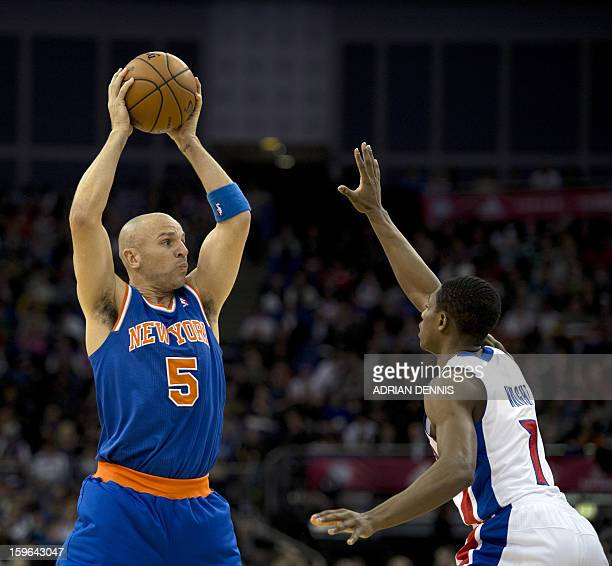 New York Knicks' guard Jason Kidd tries to pass over Detroit Pistons' guard Brandon Knight during their NBA basketball game at the O2 Arena in London...
