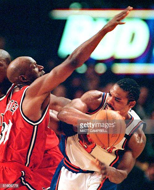 New York Knicks guard Latrell Sprewell fights Miami Heat guard Terry Porter for control of the ball in the second quarter 05 May 1999 at Madison...