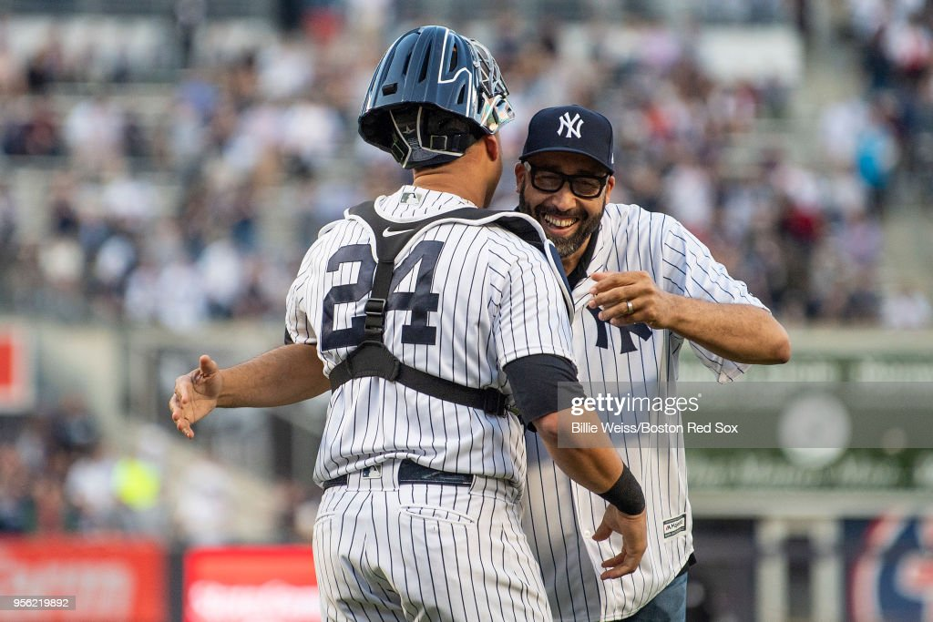 New York Knicks head coach David Fizdale reacts with Gary Sanchez #24 of the New York Yankees after throwing out the ceremonial first pitch before a game against the Boston Red Sox on May 8, 2018 at Yankee Stadium in the Bronx borough of New York City.