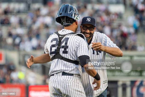 New York Knicks head coach David Fizdale reacts with Gary Sanchez of the New York Yankees after throwing out the ceremonial first pitch before a game...