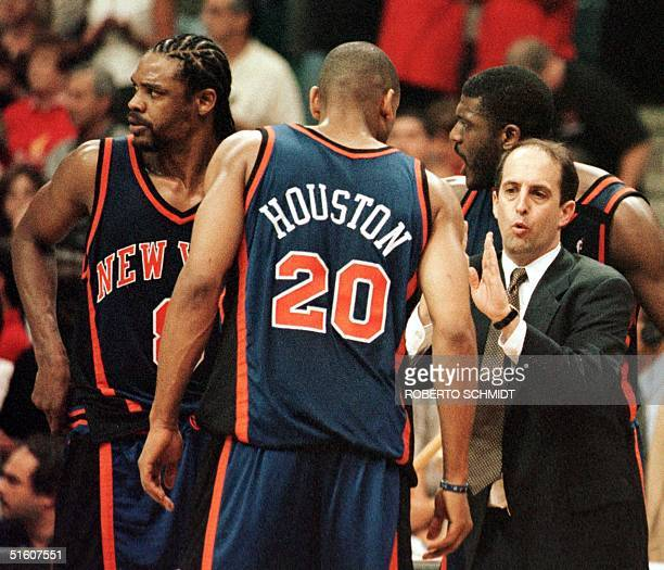 New York Knicks head coach Jeff Van Gundy talks to Latrell Sprewell Allen Houston and Larry Johnson 16 May 1999 during game five of their first round...