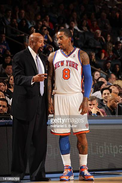 New York Knicks head coach Mike Woodson talks with JR Smith against the Detroi Pistons on March 24 2012 at Madison Square Garden in New York City...