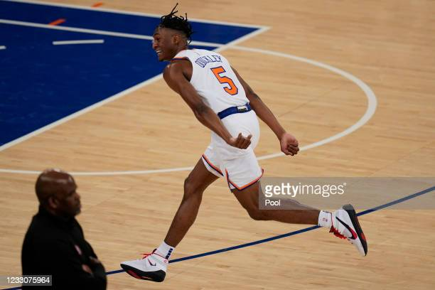 New York Knicks' Immanuel Quickley celebrates a three-point basket during the first half of Game 1 of an NBA basketball first-round playoff series...