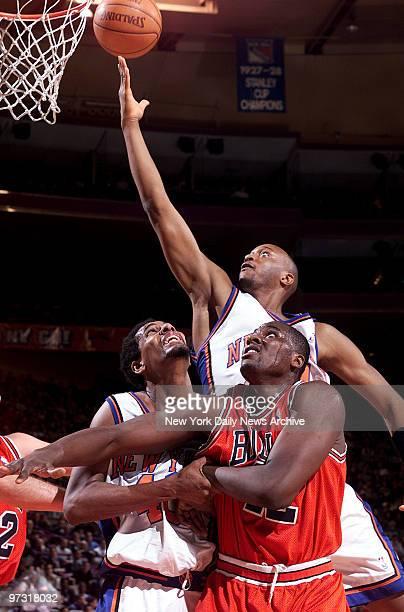 New York Knicks' John Wallace makes a layup over Chicago Bulls' Elton Brand and Knicks' Kurt Thomas during game at Madison Square Garden Knicks won...