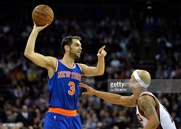 New York Knicks' Jose Calderon holds the ball in front of Milwaukee Bucks' Jared Dudley during the 2015 NBA global game between Milwaukee Bucks and...