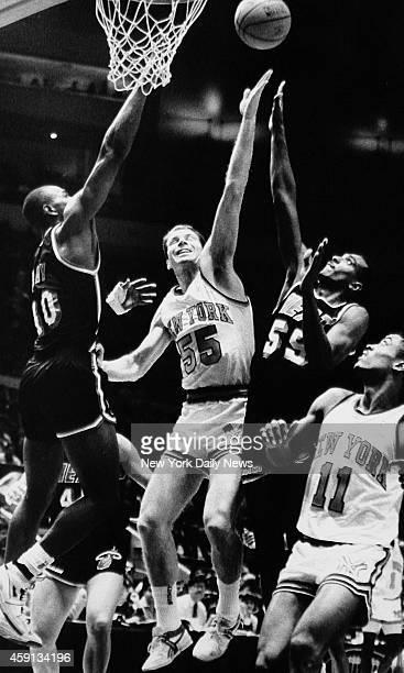 New York Knicks Kiki Vandeweghe rebounding against Miami Heat Sylvester Gray and Billy Thompson