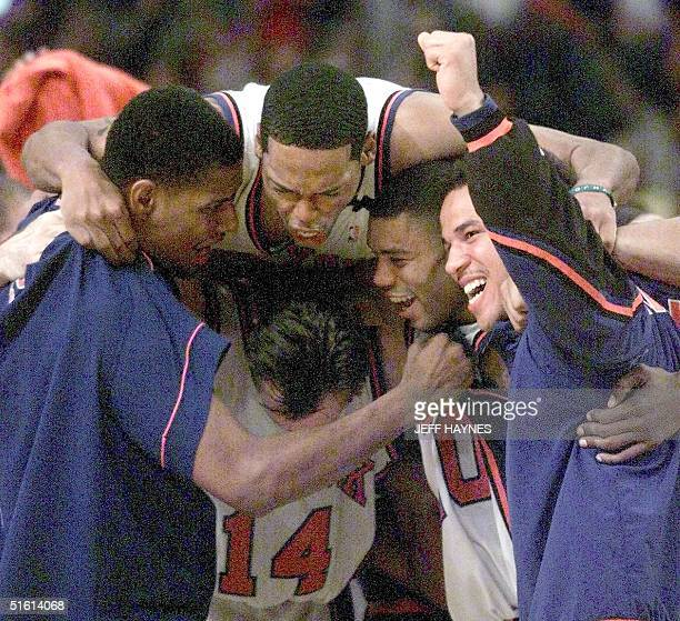 New York Knicks Kurt Thomas Marcus Camby Allan Houston Rick Brunson and Chris Dudley hug after their game against the Indiana Pacers 11 June during...