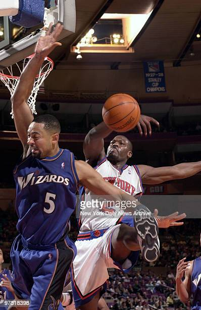 New York Knicks' Larry Johnson prevents a shot by slaping the ball away from Washington Wizards' Juwan Howard during action at Madison Square Garden...