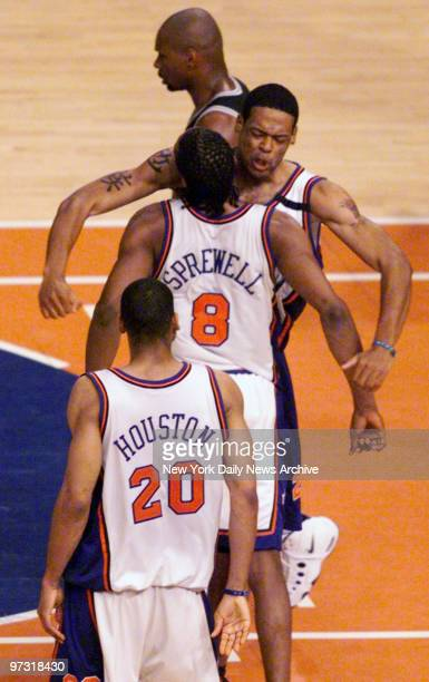 New York Knicks' Latrell Sprewell and Marcus Camby celebrate a score during Game 5 against the San Antonio Spurs in the NBA Finals at Madison Square...