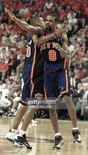 New York Knicks' Latrell Sprewell celebrates after a basket with teammate Allan Houston 08 May 1999 during game one of their first round playoff game...