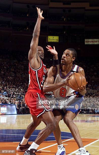 New York Knicks' Latrell Sprewell drives around Miami Heat's Terry Porter at Madison Square Garden