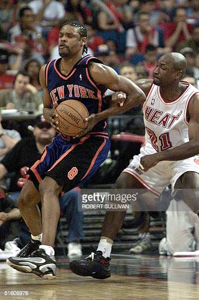 New York Knicks' Latrell Sprewell is hooked by Voshon Lenard of the Miami Heat 08 May 1999 during game one of their first round playoff game at the...