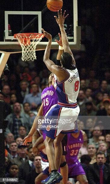 New York Knicks Latrell Sprewell puts up the gamewinning shot over Toronto Raptors forward Vince Carter with 79 seconds left on the clock in Game 2...