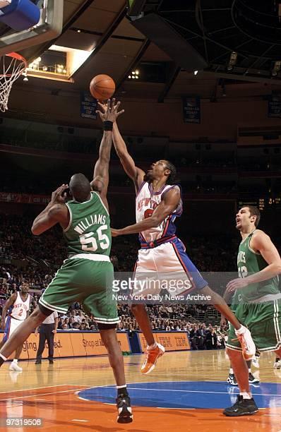 New York Knicks' Latrell Sprewell shoots over Boston Celtics' Eric Williams as the Knicks play the Celtics at Madison Square Garden The Knicks went...