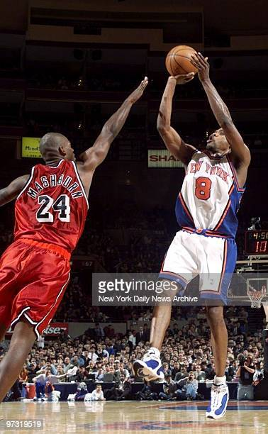 New York Knicks' Latrell Sprewell shoots over Miami Heat's defender Jamal Mashburn at Madison Square Garden