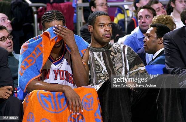 New York Knicks' Latrell Sprewell sits next to Marcus Camby in the final moments of the game as the San Antonio Spurs routed the home team 9983 at...