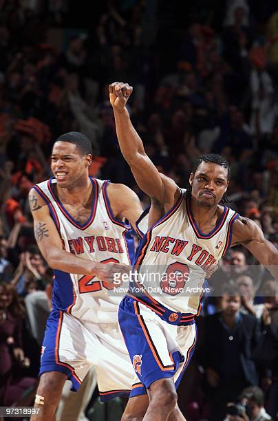 New York Knicks' Latrell Sprewell throws his fist in the air in celebration in front of teammate Marcus Camby after the Knicks beat the Raptors in...