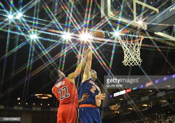 TOPSHOT New York Knicks' Luke Kornet battles with Washington Wizards' Otto Porter Jr during the NBA London Game 2019 basketball game between...