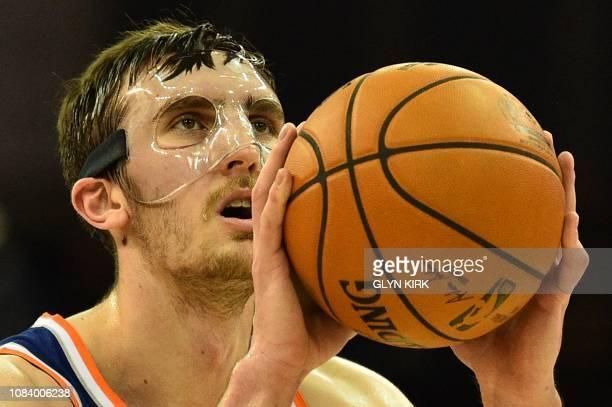 TOPSHOT New York Knicks' Luke Kornet prepares to shoot a penalty during the NBA London Game 2019 basketball game between Washington Wizards and New...