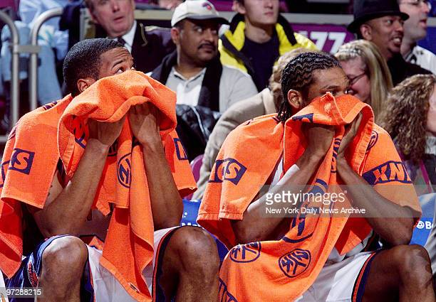New York Knicks' Marcus Camby and Latrell Sprewell cover their faces with towels in the last moments of the game against the Orlando Magic at Madison...