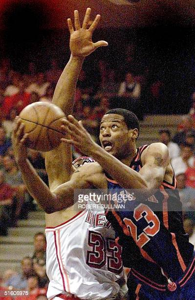 New York Knicks' Marcus Cambyl goes past Alonzo Mourning of the Miami Heat 08 May 1999 during game one of their 1st round playoff game at the Miami...