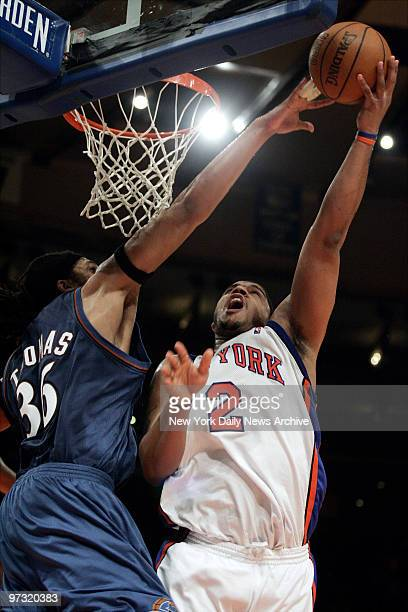 New York Knicks' Maurice Taylor is defended by Washington Wizards Etan Thomas as he ties the score at 105 during second half action at Madison Square...