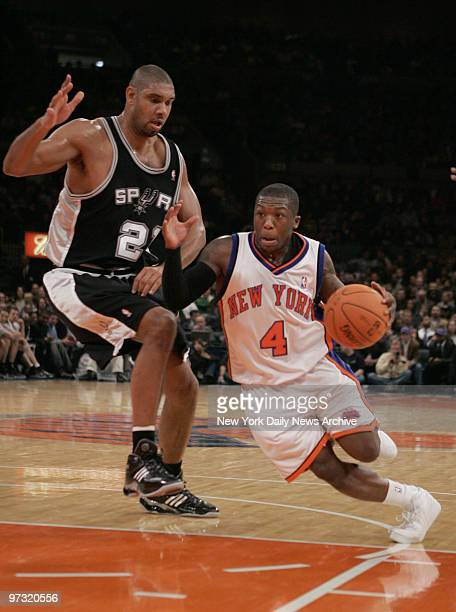 New York Knicks' Nate Robinson drives to the basket around San Antonio Spurs' Tim Duncan during a game at Madison Square Garden The Knicks went on to...