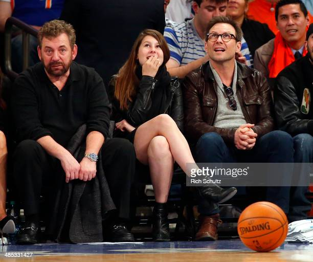 New York Knicks owner James Dolan left and actor Christian Slater right during an NBA basketball game between the Knicks and the Toronto Raptors at...