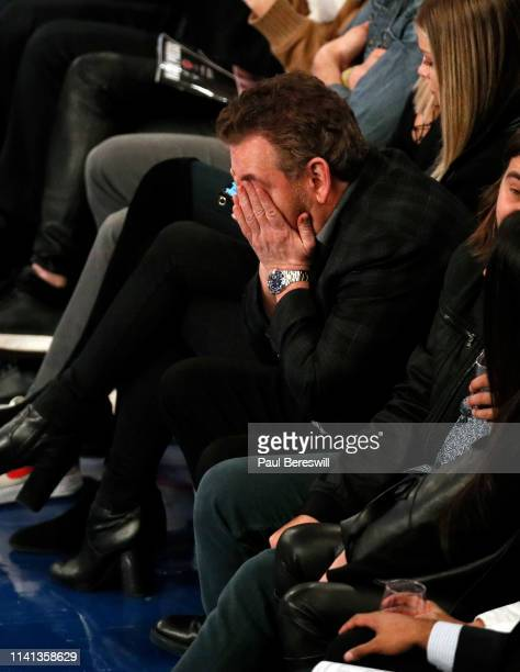 New York Knicks owner James Dolan reacts as he watches an NBA basketball game against the Toronto Raptors from his front row seat on March 28 2019 at...