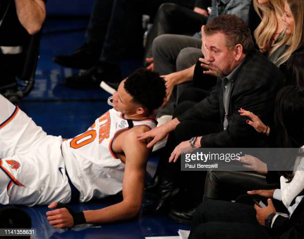 New York Knicks owner James Dolan reacts to Kevin Knox of the Knicks falling at his feet as he watches an NBA basketball game against the Toronto...