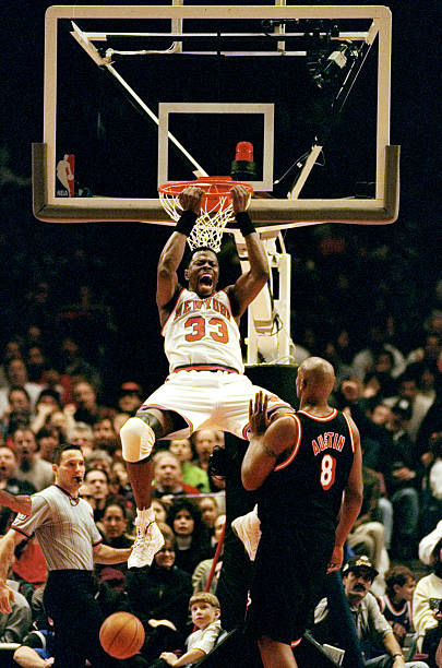 New York Knicks' Patrick Ewing does a reverse slam dunk duri