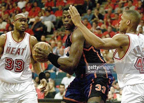 New York Knicks' Patrick Ewing works between Alonzo Mourning and PJ Brown of the Miami Heat 08 May 1999 during game one of their 1st round playoff...