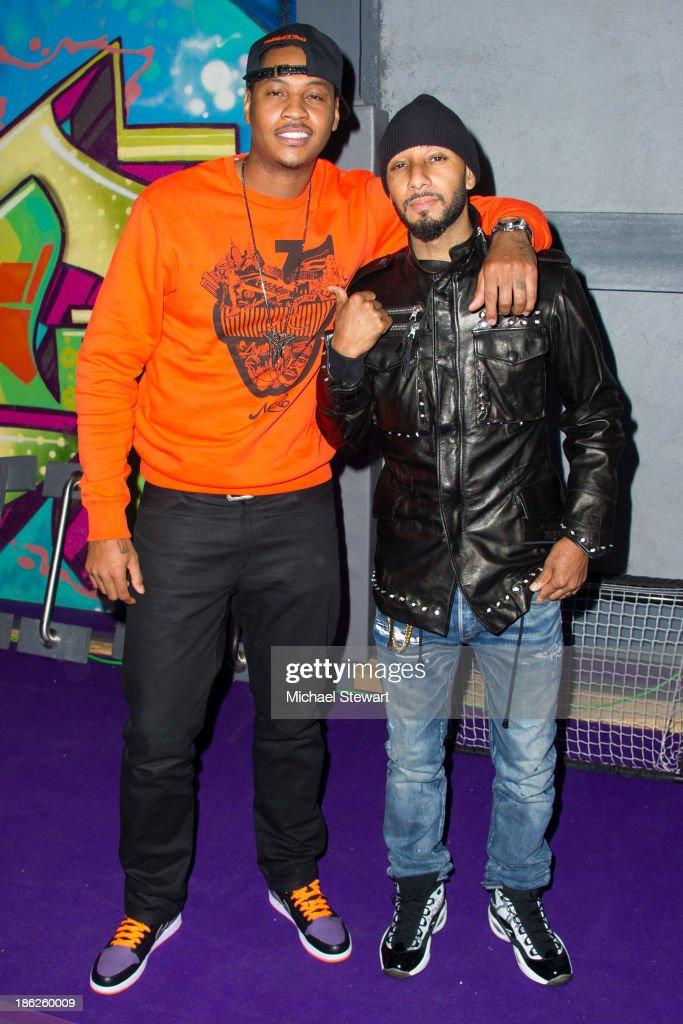 New York Knicks player Carmelo Anthony (L) and musician Swizz Beatz attend Flipeez Presents Kasseem's Dream Halloween Party at BKLYN BEAST on October 29, 2013 in Brooklyn, New York.
