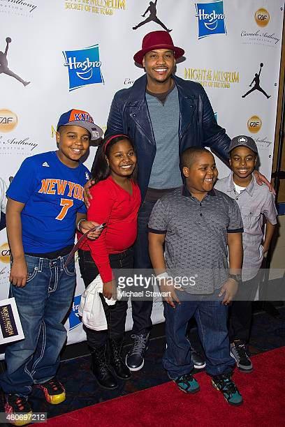 New York Knicks player Carmelo Anthony attends A Very Melo Christmas 2014 at Regal EWalk 13 on December 19 2014 in New York City