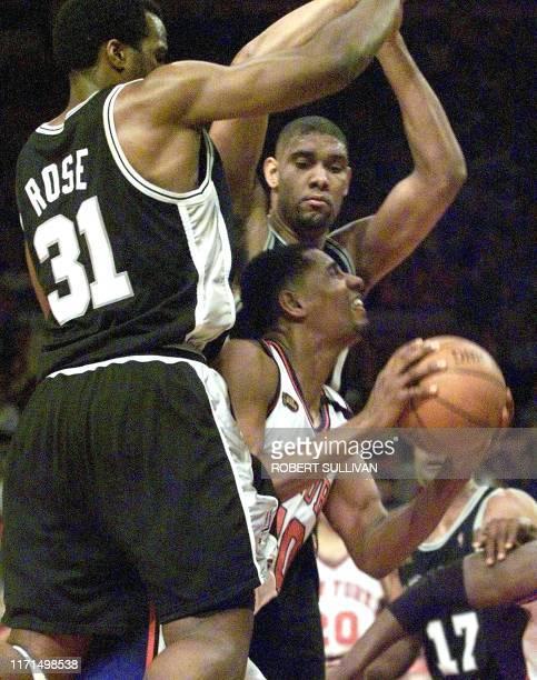 New York Knicks player Kurt Thomas looks for a shot between San Antonio Spurs Malik Rose and Tim Duncan during game four of the NBA Finals 23 June...