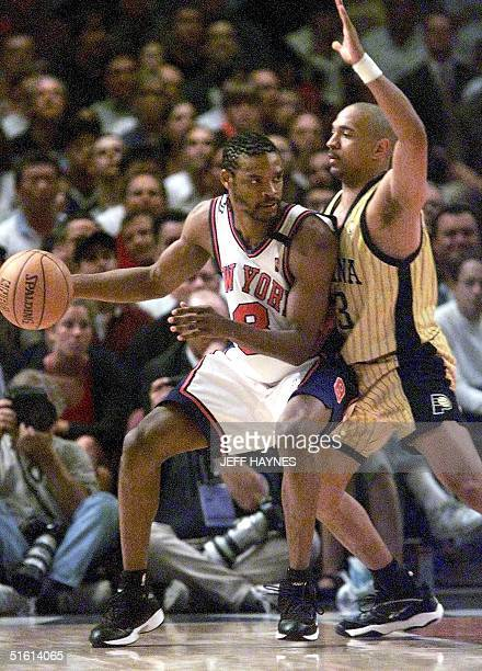 New York Knicks player Latrell Sprewell drives into Indiana Pacers player Mark Jackson 11 June during the NBA Eastern Conference Finals at Madison...