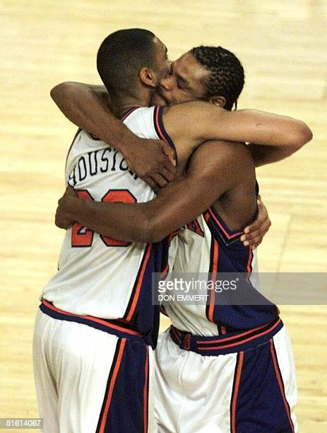 New York Knicks player Latrell Sprewell hugs teammate Allan Houston late in the fourth period in the Knicks game against the Indiana Pacers 11 June...