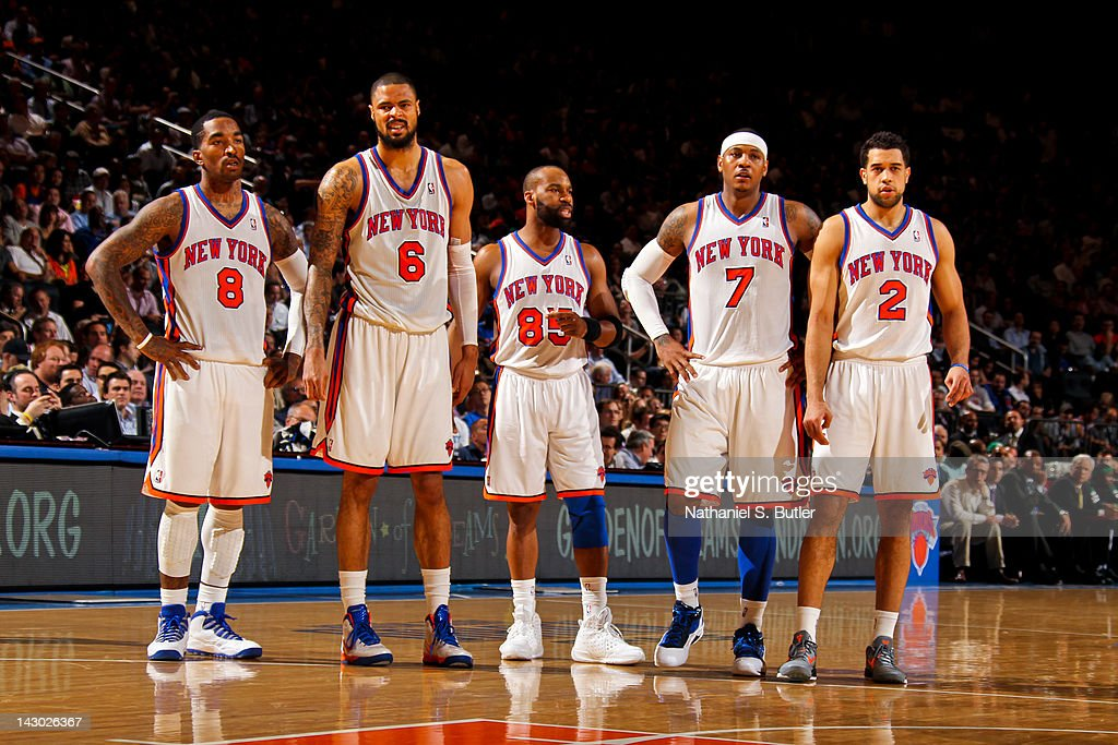 New York Knicks players J.R. Smith #8, Tyson Chandler #6, Baron Davis #85, Carmelo Anthony #7 and Landry Fields #2 stand on court during a break in action against the Boston Celtics on April 17, 2012 at Madison Square Garden in New York City.