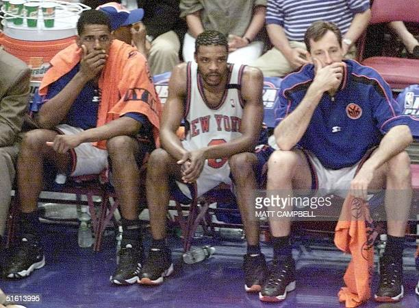 New York Knicks players Kurt Thomas Latrell Sprewell and Chris Dudley sit on the bench near the end of their game against the Indiana Pacers 07 June...