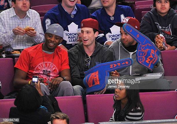 New York Knicks players Patrick Ewing Jr Andy Rautins and Landry Fields attend the Toronto Maple Leafs vs New York Rangers game at Madison Square...