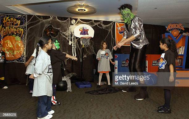New York Knicks' rookie center 7'5 Slavko Vranes plays the part of Frankenstein in a skit with a group of students during the New York Knicks Read To...