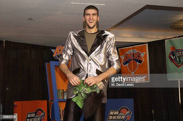 New York Knicks' rookie center 7'5 Slavko Vranes smiles after playing the part of Frankenstein in a skit with a group of students during the New York...