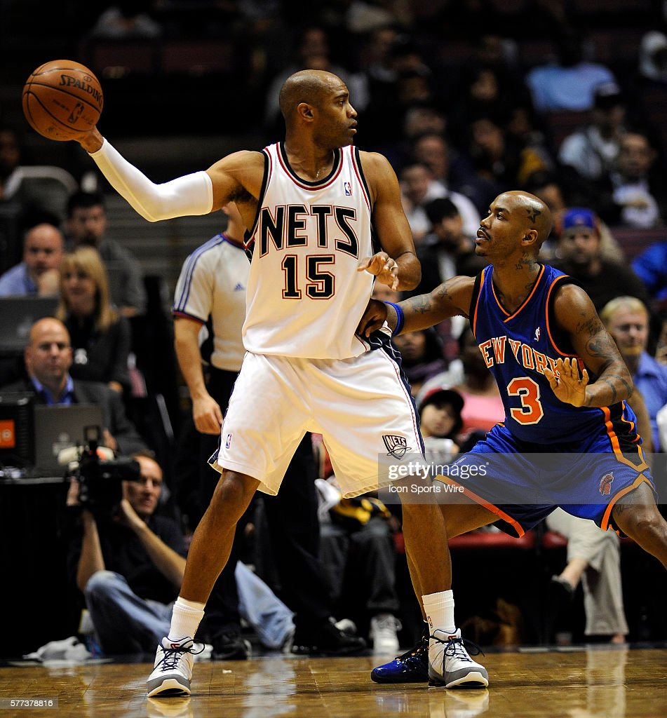 New York Knicks Stephon Marbury guards New Jersey Nets Vince Carter in the first half at East Rutherford, N.J., October 20, 2008.
