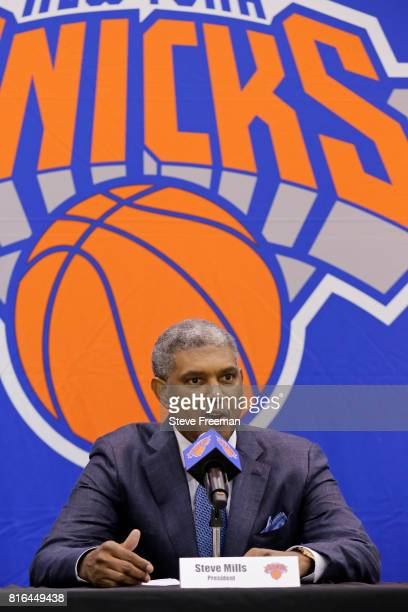 New York Knicks team President Steve Mills and Jeff Hornacek of the New York Knicks introduce General Manager Scott Perry at a pess conference at the...
