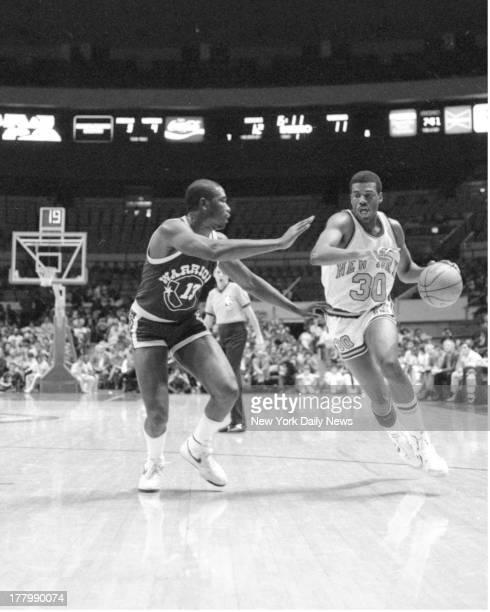 New York Knicks vs Golden State Warriors Knicks' Bernard King shifts gears as he drives past Warriors' Larry Smith