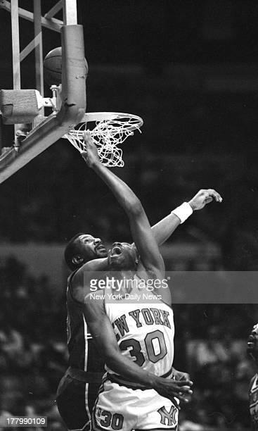 New York Knicks vs Washington Bulltets Bernard King scores on a reverse layup