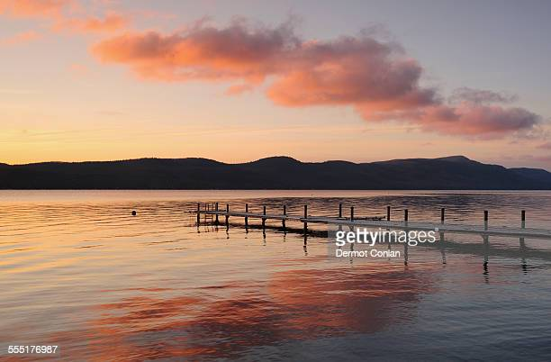 usa, new york, lake george, jetty on lake at dawn - lake george new york stock pictures, royalty-free photos & images